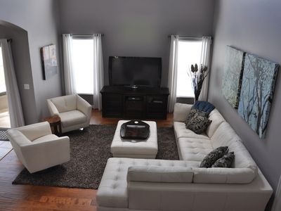 Living room with plenty of comfortable seating and large flat-screen TV.