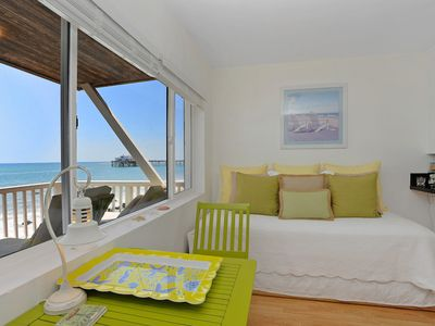 Day bed and seating area with ocean view of Malibu pier