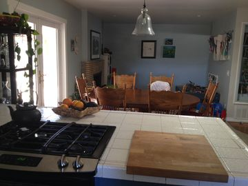 Isla Vista house rental - View from kitchen into dining room, playroom and french doors to the backyard