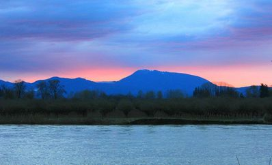 Looking out over the river at sunset. Mary's Peak in the background