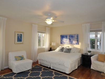 Master bedroom with king size bed, walk in closets.