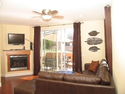 Comfortable living room-working fireplace, balcony, flat screen tv, big windows
