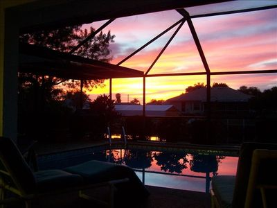 Sunset from the lanai reflected in the pool- a great afternoon western exposure