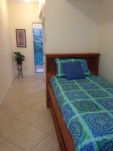 Twin bed in the hallway.