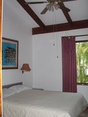 Playa Hermosa villa photo - Master bedroom with queen size bed. Ensuite and washing machine to the right.