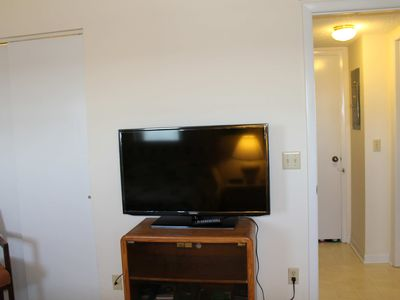 There is a new flat screen TV in Bedroom 2. The bathroom is outside the door.