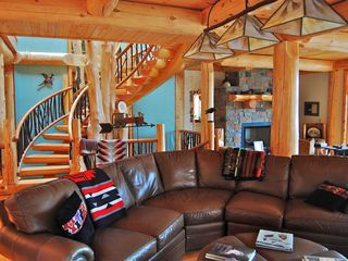 Cooperstown cabin photo - Leather sofa, vintage trading blankets and hand-painted chandeliers