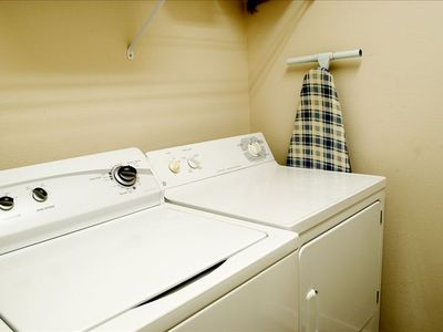 Full sized washer and dryer in their own laundry room is just like home.