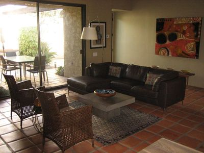 Palm Springs condo rental - Living room with entrance in far corner