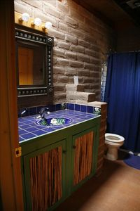 Guest bath with saguaro rib cabinets