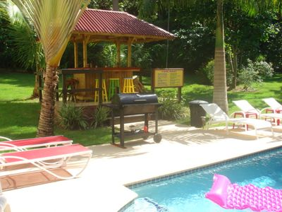 Tropical Poolside Tiki Bar w/electricity, lights and Barrel BBQ Smoker.