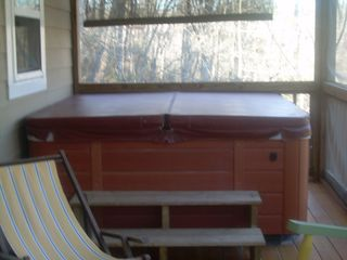 Helen cottage photo - hot tub on covered screen porch over looking the river
