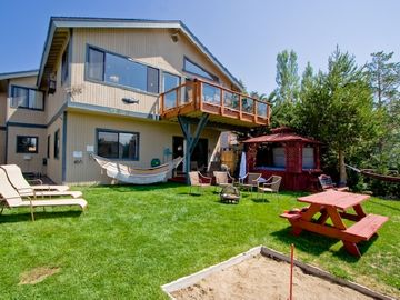 Rear garden: private dock, lawn furniture, fire pit, horse shoe toss, hot tub.