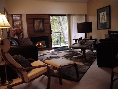 The living room is comfy and cozy  with two leather couches and areading chair