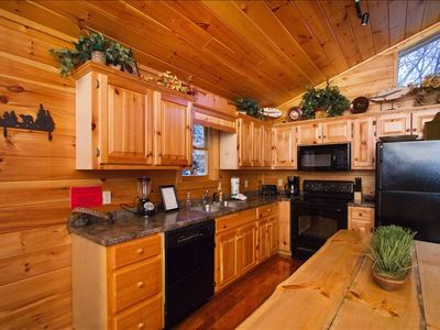 Kitchen w/all appliances ready to prepare any meal + Custom Log table!