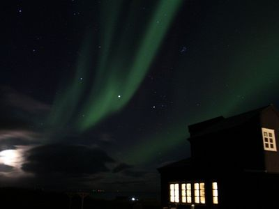 Northern lights and stars dancing over our cottage