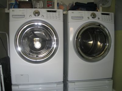 Washer and dryer located off kitchen.