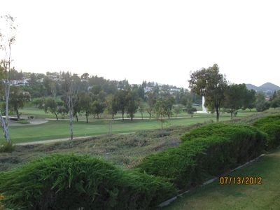 Landscape view of golf course and green belt offers serenity.