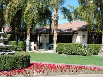 Rancho Mirage house rental - Patio of home looking out to the bubbling fountain, mountains and lawn.
