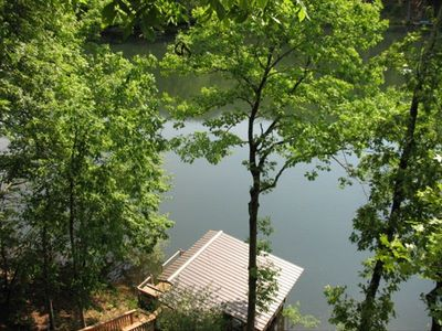 View of Back deck to lake and boat house