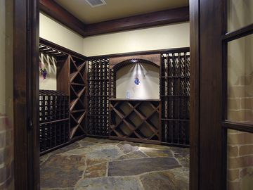 1000 bottle, temp. controlled wine room. Redwood - 3 inch natural stone floors.