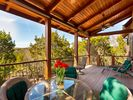 20' covered deck with views of the Texas Hill Country. Great place for dinner.