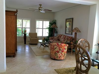 Living room with HDTV & WiFi and access to lanai & heated quiet community pool
