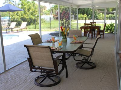 Screened Lanai w/ 90' Table & Swivel Chairs, Wooden Card/Gaming Table