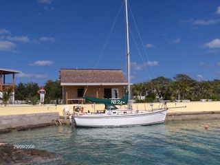 Great Exuma cottage photo - Docking facility, swimming steps and shower. Boat House in back ground