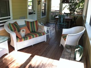 The porch also has a large farm table. Great for outdoor dining or playing games