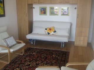 Lyon studio photo - Armoire and sleep sofa (opens to queen-size)