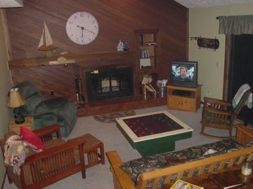 Boyne Highlands condo rental - Living room with fireplace and doorwall to large deck area