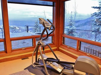 Workout room overlooking fire pit and Jordanelle Reservoir