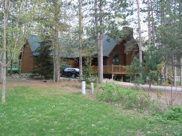 Crystal Mountain, Thompsonville house rental - Home surrounded by tall pines & maple trees