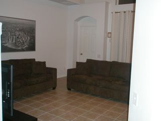 Windsor Palms house photo - Open plan living area with flat screen HDTV and DVD - patio access to pool area