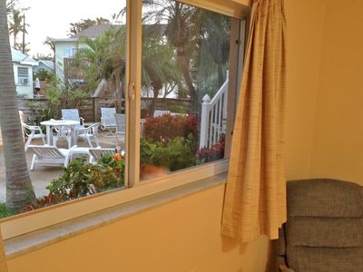 Anna Maria villa rental - Rear window, faces the large enclosed (east side) patio & picnic area