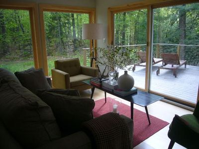 The living area with windows onto the woods