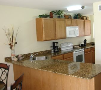 Modern kitchen with granite counter-top and all new appliances