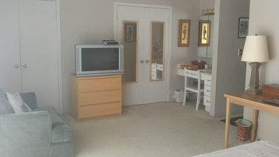 Master br, tv, dresser, vanity sink, hair dryer, loveseat, 2 double closets