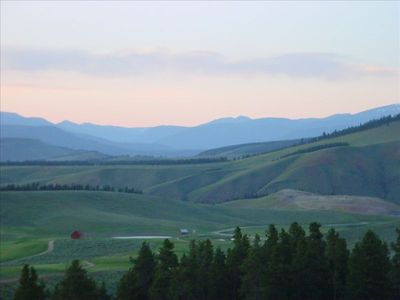 Summer view of the Continental Divide and Headwaters golf course from our deck.