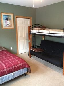 1rst floor bedroom with Futon bunk and a Queen bed. Perfect for Kids