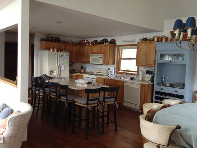 Modern kitchen opens to new dining table for 8-10 & family room & lake view