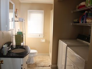 Standish house photo - bathroom with full size washer & dryer