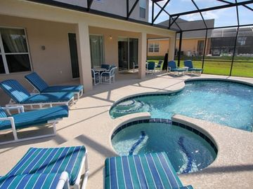 Pool area with spa and large lanai