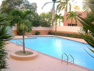 Isla Verde apartment photo - Pool area only for our guests with a BBQ area, bathrooms etc...