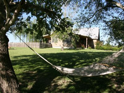 San Marcos cottage rental - A hammock near the front is close enough to read a newspaper thru WiFi signal