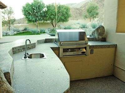 Grill and outdoor sink.