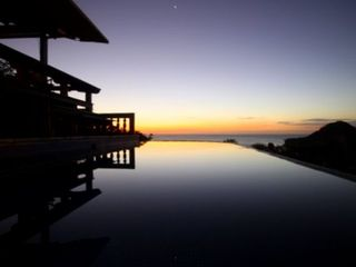 Bahia Gigante villa photo - Swim or lounge in your private infinity pool sunset or evening under the stars