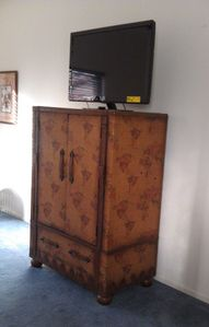 Master armoire with new flat screen TV