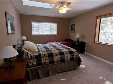 Bedroom with queen bed and single bed.